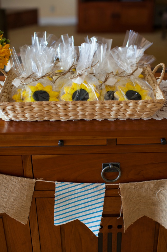 Sunflower sugar cookies make a cute gift for the guests so they can take a piece of the party home.