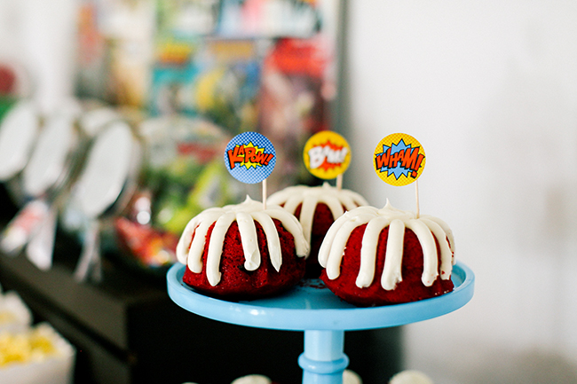 Mini Bunt Cakes with Super Hero Comic Book signs - perfect for a super hero birthday party!