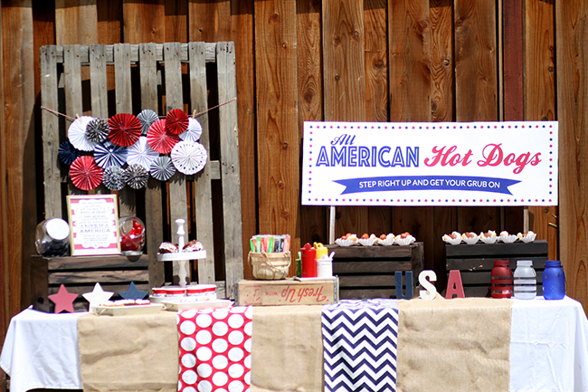 The perfect food station for a fourth of July party! Hot dogs and simple sweets like cookies and push pops are great for an outdoor summer party.