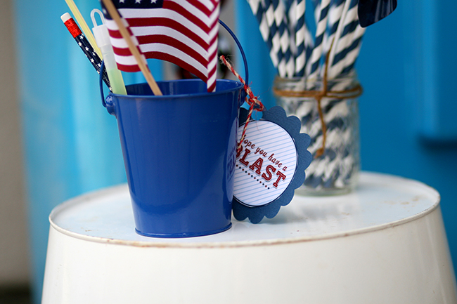 Add a few small treats or toys in a bucket as a gift for your younger guests. They will love it! | July 4th party ideas.