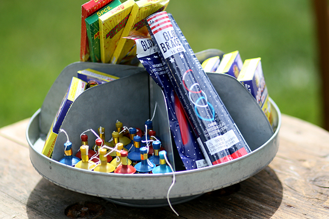 An old electrical spool is perfect for holding fireworks. Great upcycle idea!