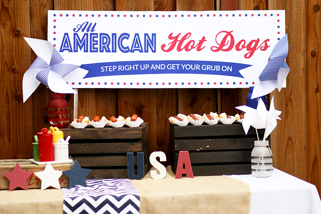 Don't forget the condiments and a cute sign when you create a hot dog stand! Love the idea to set them up high on old pallets. Great for an outdoor party.