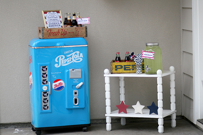 July 4th party drink station with a vintage feel! I love this old refrigerator. Bottled cokes and lemonade are perfect refreshments for an outdoor summer party.