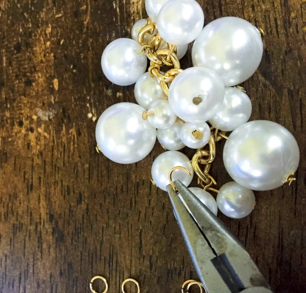 Use jump rings to attach your pearl clusters to the necklace.