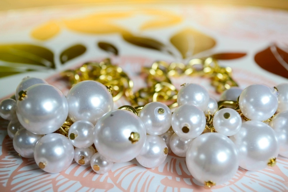 Make your own pearl cluster necklace.