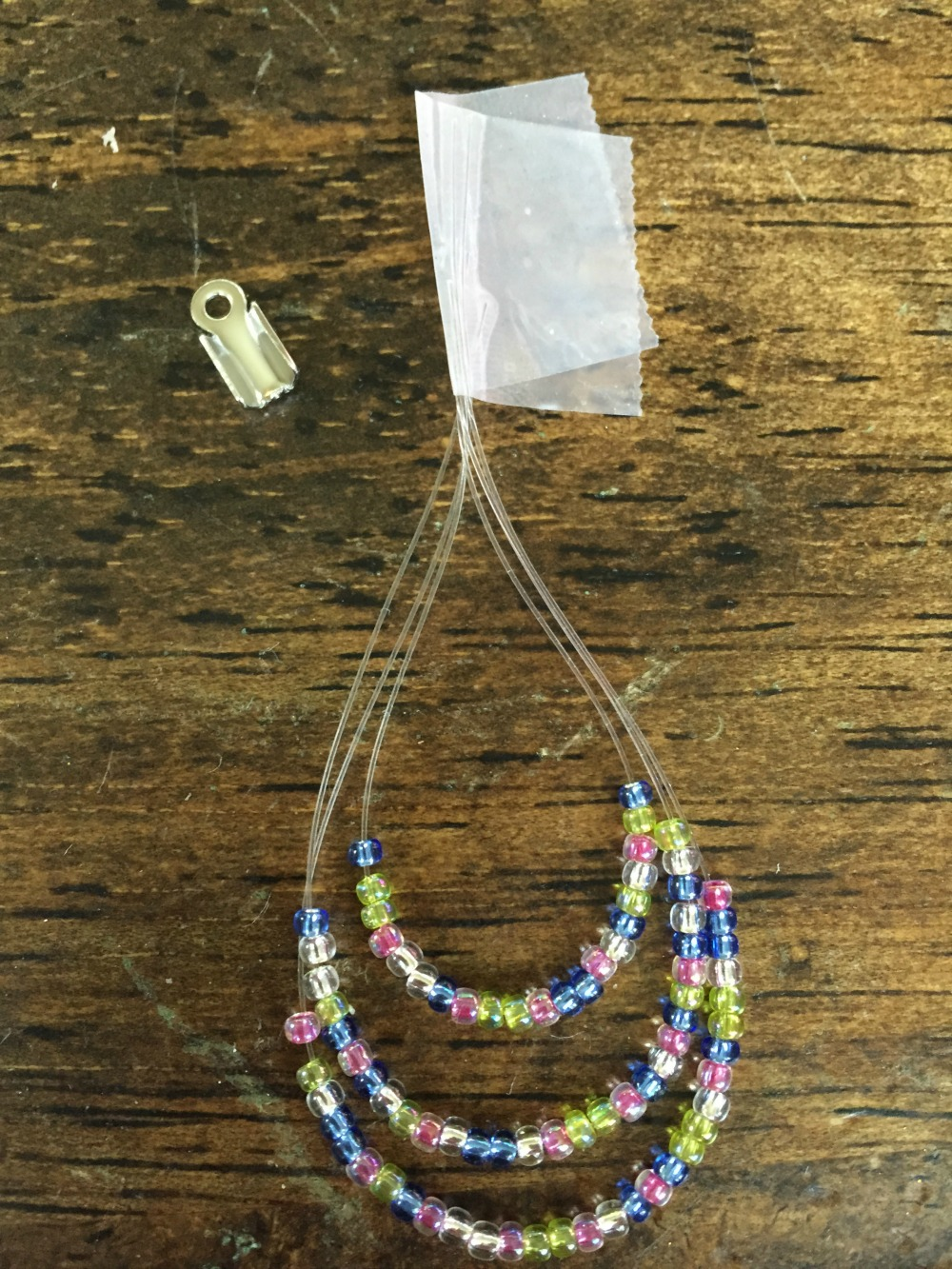 Add color to your summer wardrobe with these DIY rainbow hoop earrings.