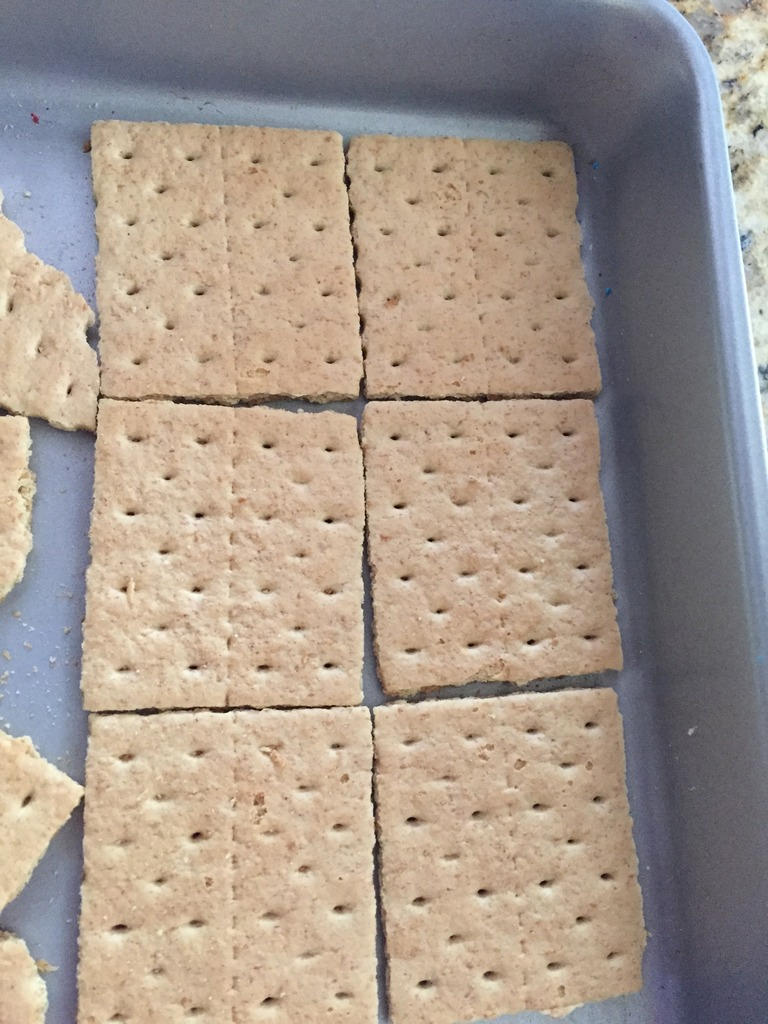 Line your pan with graham crackers as a base for S'mores Bars.