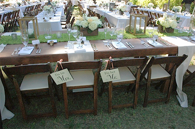 The wedding head table. Love the little signs and how well the rustic touches mix with the classic pieces.
