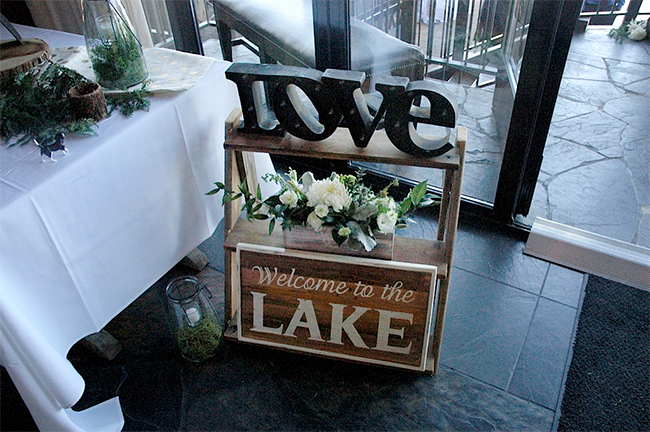 Signs are a big thing for weddings this summer. Love how they incorporated them throughout the decorations.