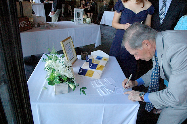 Instead of just signing their name, guests write little notes to the bride and groom. Love this wedding guest book idea! Looks like an easy DIY project.