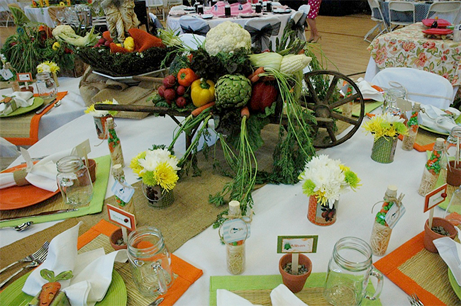 I love all the different things that came together on this table - flowers, vegetables, candy, burlap, nice table cloth, terra cotta pots, and more. This is super cute for a summer party.