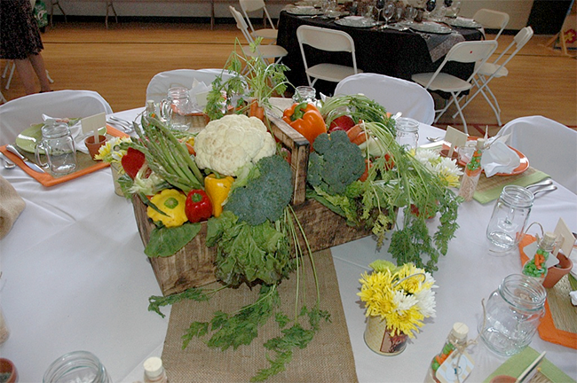 Vegetables in an old crate make a cute centerpiece for a summer garden party. Send them home with your guests after the party, or use them to make dinner for your family!