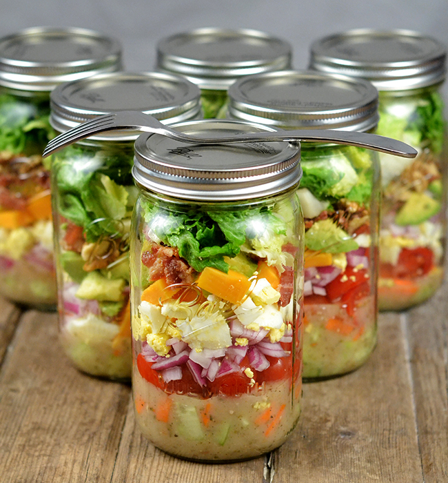 Mason Jar Salads are the perfect summer salad recipe. Make a week's worth over the weekend, and you will have an easy healthy lunch you can take to work with you each day.