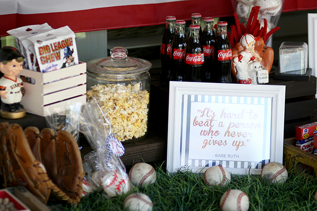 Use your old balls and mits to decorate the food bar at your baseball party. Super simple! Super cute.