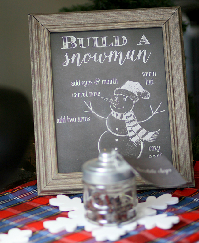Fun activity for a Christmas party is a build your own snowman station. Get the free printable here.