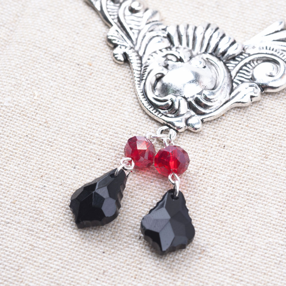Connect your red and black beads to the triangle piece.