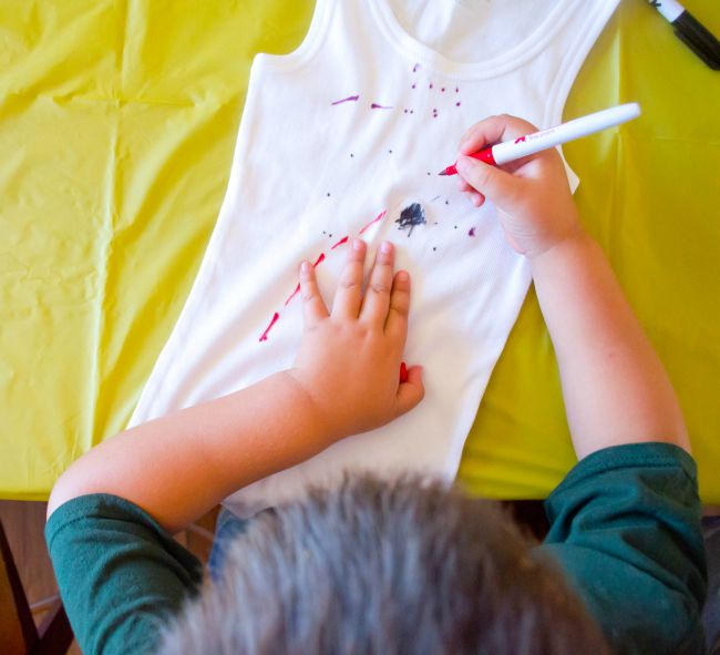 Add dots, lines, and other marks all over your tank top with the sharpie.