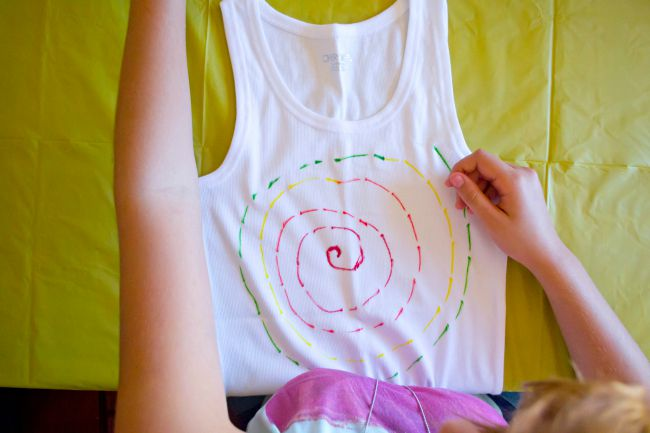 Start with dots and a swirl pattern if you want your finished product to come out with a traditional tie-dye feel.