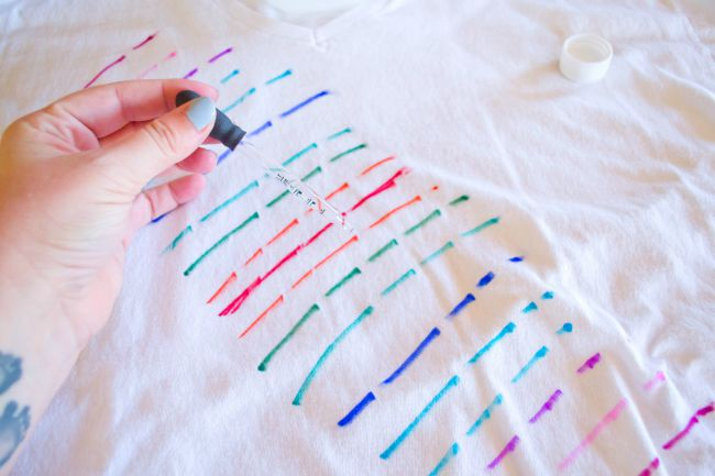 Use a dropper to apply the rubbing alcohol to your tank top or t-shirt.