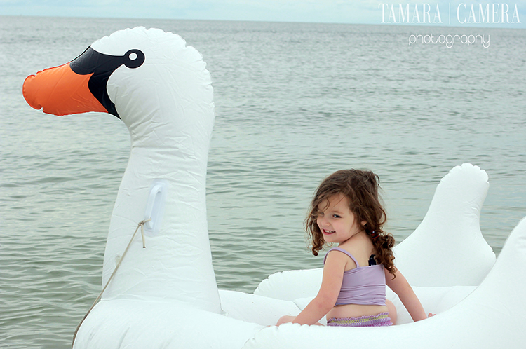 Little girl in a swan boat.