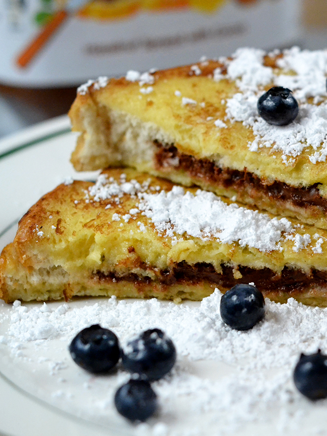 Don't just top you french toast with Nutella, add it before you cook the bread.