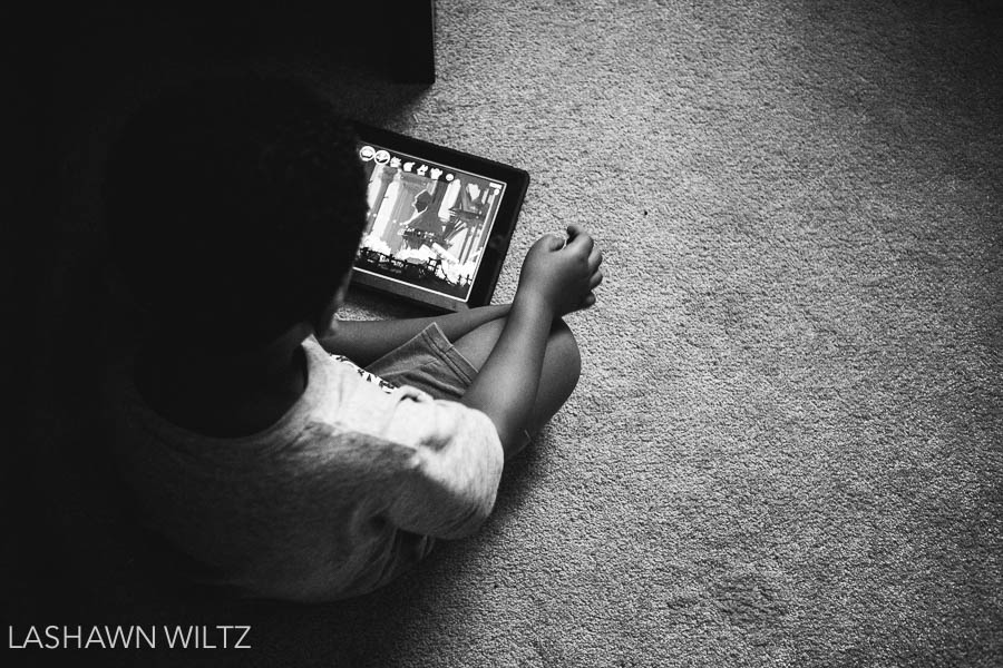 Child watching movie on tablet.