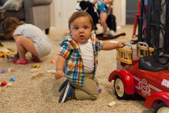 Baby With A Toy Fire Truck