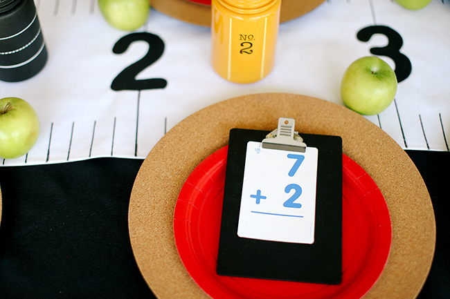 Flashcards and clipboards are super cute table decorations for a back to school theme party.
