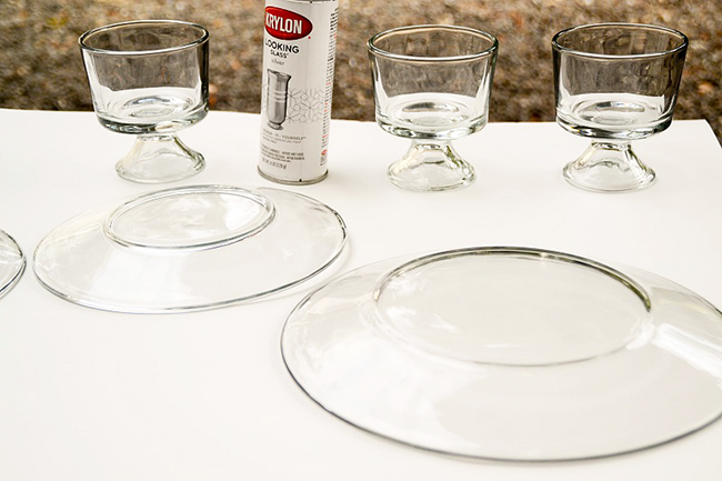 Start with clear plates of different sizes to make a layered cake stand.