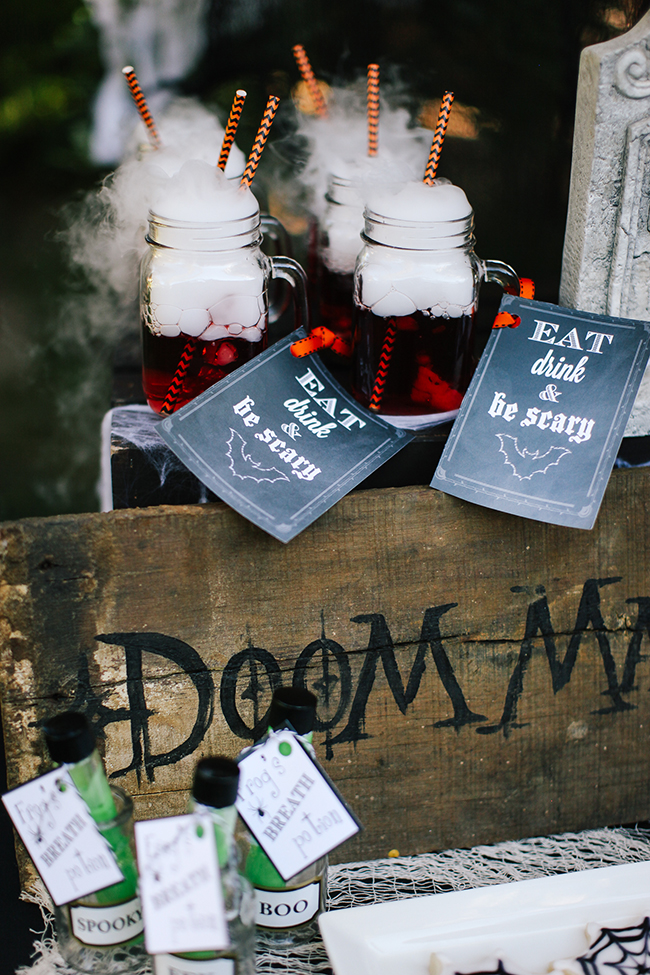 Spiderwebs, Dry ice, and rustic wooden signs are the perfect combo for creepy Halloween decorations!