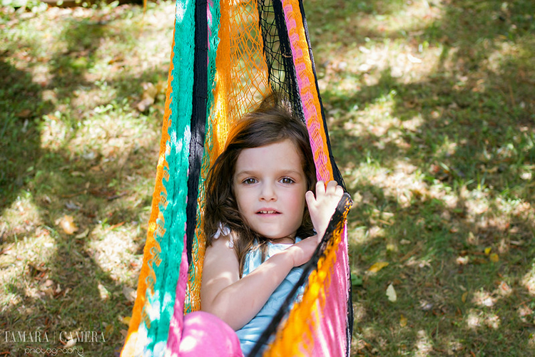 Girl in hammock at the beach.