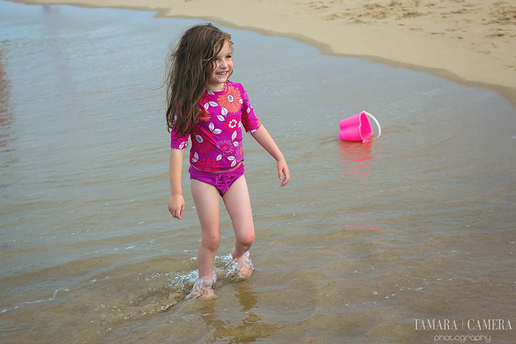 Use a low ISO setting when you are taking beach pictures.
