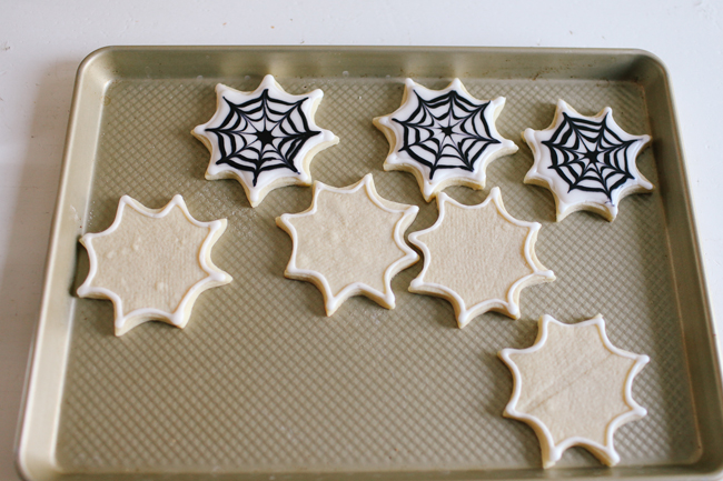 These sugar cookies show how you should outline them before flooding the inner.