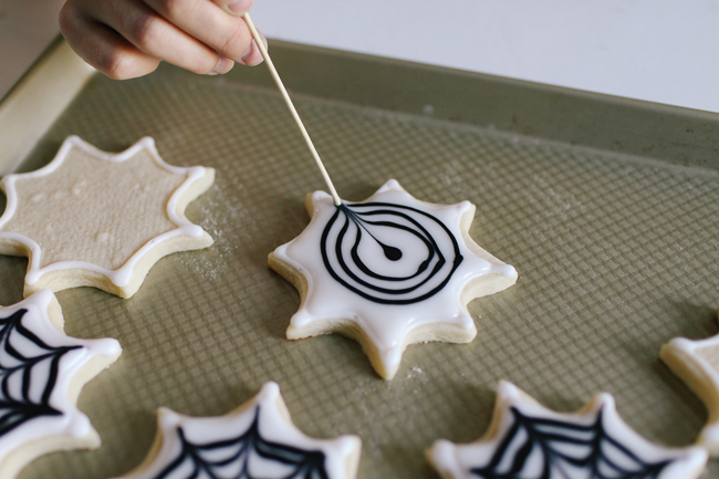 Use a toothpick to create the most awesome Spiderweb design for these delicious cookies.