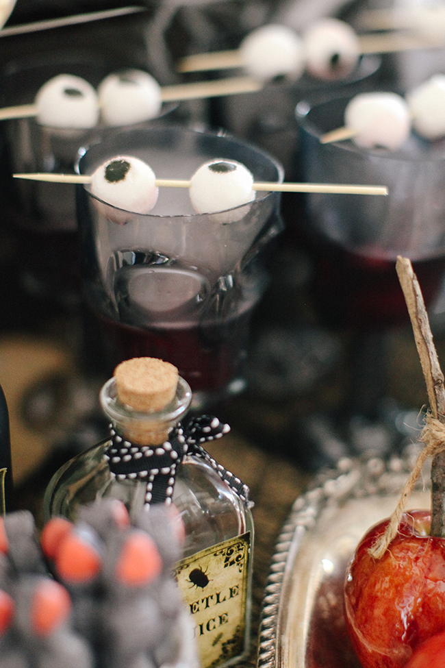 Gummy eyeballs and dry ice are the perfect addition to any spooky Halloween Punch. Especially if it is served at an Evil Queen Party like this one!