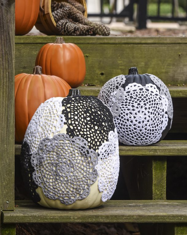 Doily pumpkins are a cute way to do a halloween craft with pumpkins!