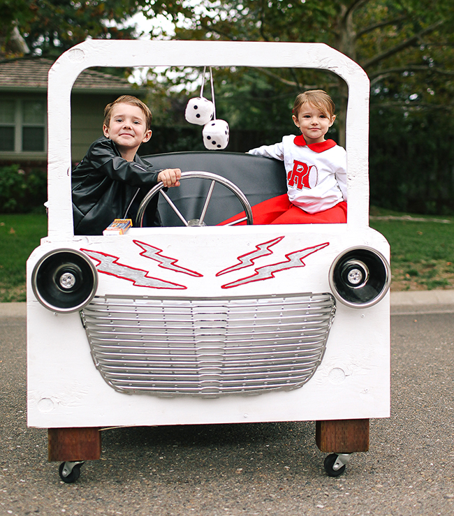 These Grease costumes are perfect because of the Grease Lightning car!