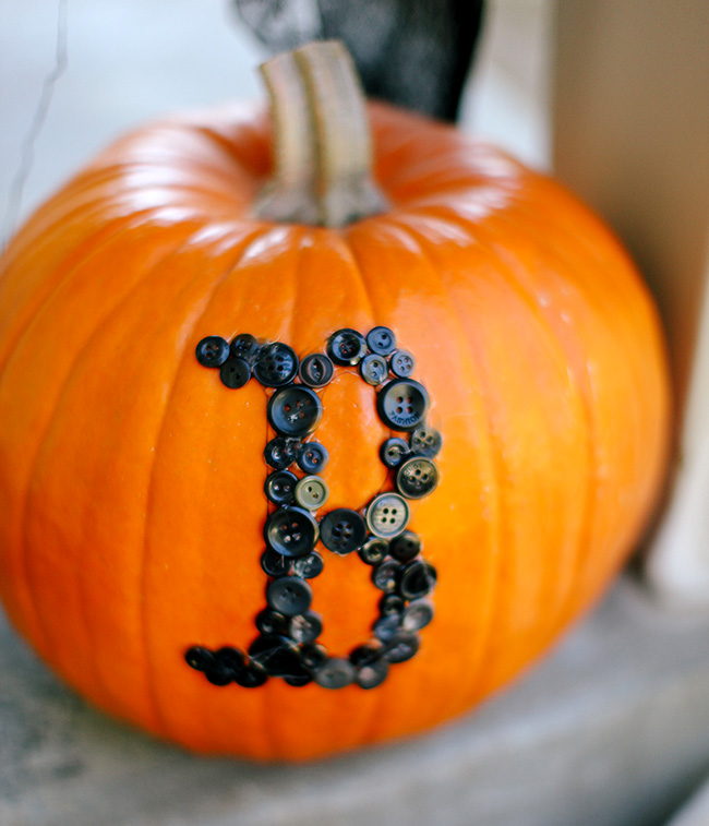 Use leftover buttons to create cute words on pumpkins!