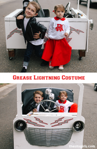 Kids dressed as Danny and Sandy with grease lightning car