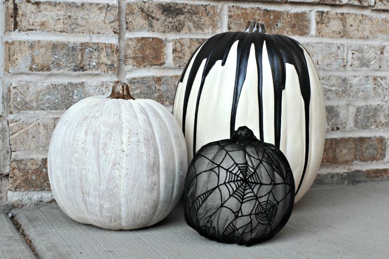 Trio of painted pumpkins.