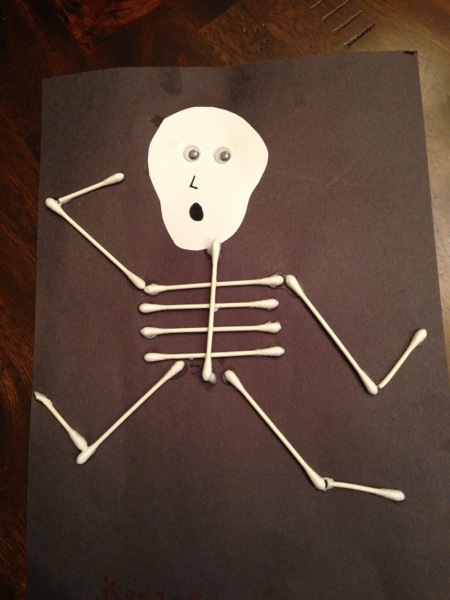Use bathroom Qtips to make this cute skeleton!