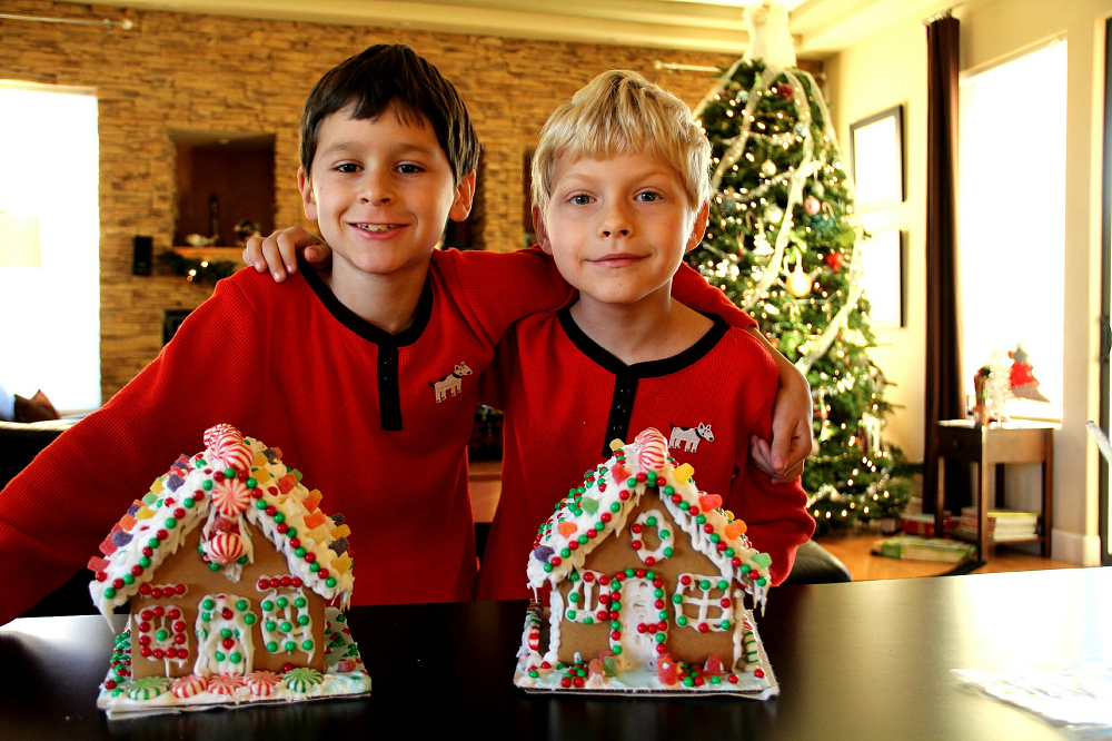 Kids with finished gingerbread houses