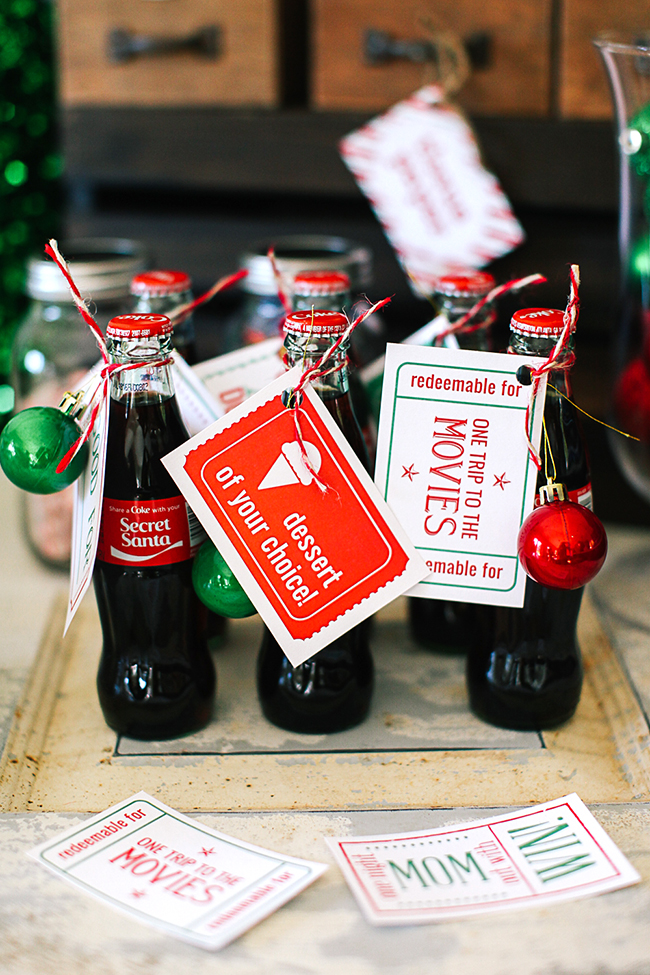 A cute idea for secret santa - attach an ornament and a printable Christmas coupon to a Coke bottle for a cute gift.