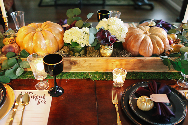 Use natural elements and candles to create a romantic table.