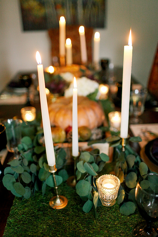 Use mismatched gold candlesticks to create a dramatic look.