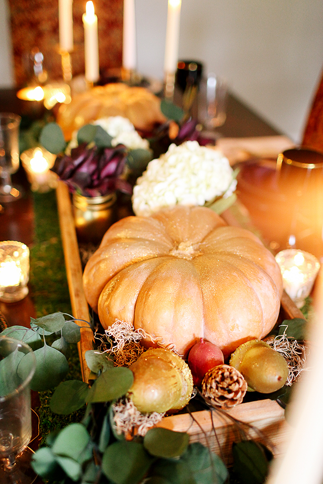 Use cinderella pumpkins for a romantic tablescape. Spay them with gold glitter to transform them!
