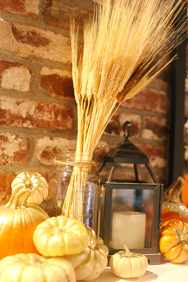 We love using wheat and pumpkins to create a natural display in our fall decor!