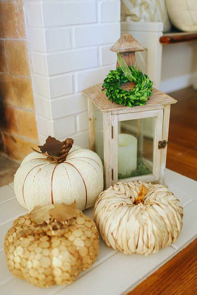 Use lanterns to bring the outside into your mantle decor.