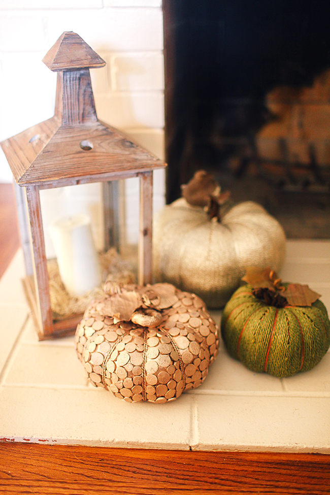 Use lanterns and faux pumpkins to create simple and clean decor!