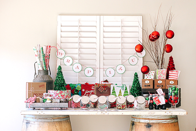 Use classic Christmas colors to make a bright display for your Wrapping paper party!